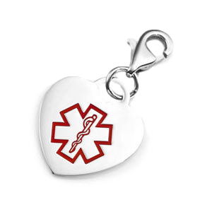 heart-shaped charm with red medical symbol