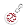 Round charm with red medical symbol.